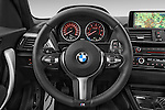 Car pictures of steering wheel view of a 2015 BMW 1 Series M Sport 5 Door Hatchback Steering Wheel