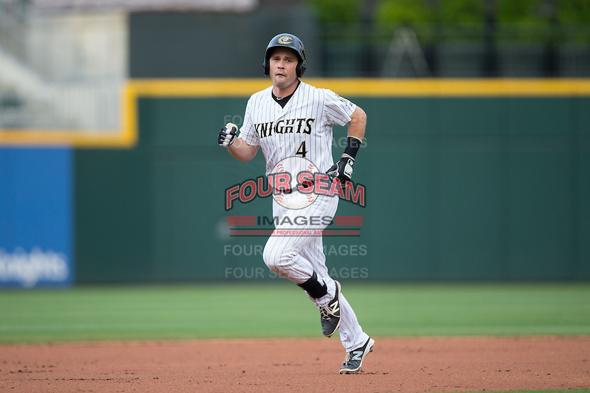 Vinny Rottino (4) of the Charlotte Knights rounds the bases after hitting a home run against the Syracuse Chiefs at BB&T BallPark on June 1, 2016 in Charlotte, North Carolina.  The Knights defeated the Chiefs 5-3.  (Brian Westerholt/Four Seam Images)