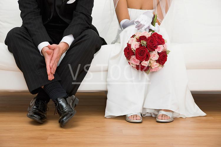 USA, Illinois, Metamora, Bride and groom sitting on sofa