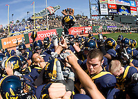 California players huddle together before the game against Presbyterian at AT&T Park in San Francisco on September 17th, 2011.  California defeated Presbyterian, 63-12.