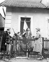 """Frenchwoman exclaims to neighbor and to American soldier: """"Tout Belfort Est Libre"""" (All Belfort is liberated).  November 25, 1944. Leibowitz. (Army)<br /> NARA FILE #:  111-SC-196728<br /> WAR & CONFLICT #:  1052"""