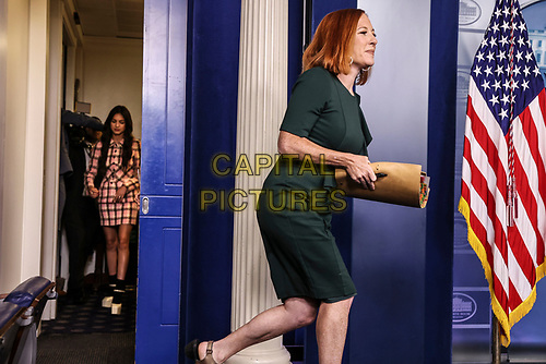 Jen Psaki, White House press secretary, right, joined by Olivia Rodrigo, arrive during a news conference in the James S. Brady Press Briefing Room, at the White House in Washington, D.C., U.S., on Wednesday, July 14, 2021. <br /> CAP/MPI/RS<br /> ©RS/MPI/Capital Pictures