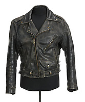 """COPY BY TOM BEDFORD<br /> Pictured: A black leather motorcycle jacket worn by Patrick Swayze as Johnny Castle in Dirty Dancing (Great American Films, 1987) and as Chuck """"Tiger"""" Warsaw in Tiger Warsaw (Continental, 1988) and in promotional images for Dirty Dancing.<br /> Re: The iconic black leather jacket worn by Patrick Swayze in the hit film Dirty Dancing has sold for $50,000 (£38,612) at auction.<br /> It was bought by a fan after the tragic actor's wife decided to sell his movie memorabilia. <br /> The jacket had a reserve of just $6,000(£4,630) at the auction in Los Angeles but an internet bid of $25,000(£19,300) was received before the auction started.<br /> The salesroom erupted with applause when the hammer came down at $50,000.<br /> Auctioneer Darren Julien said: """"We always knew it would fetch big bucks.<br /> """"The jacket is the holy grail for Patrick Swayze fans and there are a lot out there.""""  <br /> The heart throb actor wore the James Dean-style jacket throughout Dirty Dancing including the  scene where he says: """"Nobody puts Baby in a corner"""".<br /> The jacket belonged to Swayze before the movie was made in 1987.<br /> Dirty Dancing was a low-budget movie and most of the clothes Swayze's wore were his own, including the leather jacket.<br /> Mr Julien said: """"Because it was his jacket he got to keep it after the movie and wore it whenever he felt like it."""