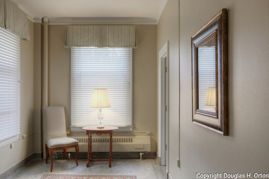 Sitting room, coat room or ante room outside restroom in lodge.  Dating to 1927, the Masonic Retirement Center, locally known as the Masonic Home, in Des Moines, Washington is now an elegant event center available for rental.  In the historic Zenith neighborhood of the city of Des Moines. Please conact douglasorton@comcast.net regarding licensing of this image.