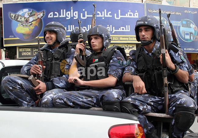 Palestinian police troops parade in the West Bank town of Hebron on 16 November 2009 during a rally marking the symbolic declaration of independence Day. Photo by Najeh Hashlamoun