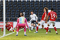 Connor Roberts of Swansea City (C) crosses the ball to the Bristol box during the Sky Bet Championship match between Swansea City and Bristol City at the Liberty Stadium, Swansea, Wales, UK. Saturday 27 February 2021