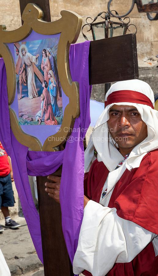 Antigua, Guatemala.  Penitent in a Semana Santa Procession.