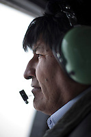 Oruro, Bolivia<br /> A picture dated January 12, 2015 shows Bolivian President Evo Morales wearing headphones and a microphone while flying on his helicopter in the Uyuni Salt Desert.
