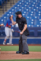 Home plate umpire Tyler Wall calls a strike during an Arizona League game between the AZL Rangers and the AZL Brewers Blue on July 11, 2019 at American Family Fields of Phoenix in Phoenix, Arizona. The AZL Rangers defeated the AZL Brewers Blue 5-2. (Zachary Lucy/Four Seam Images)