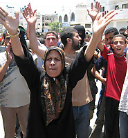 "Palestinain woman celebrate after capturing a building belonging to the pro-Fatah security forces loyal to President Mahmud Abbas in Gaza June,14,2007.""photo by Fady adwan"""