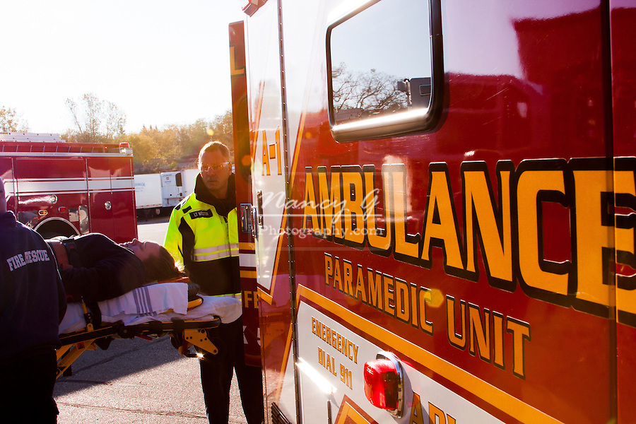 An EMT loading a patient into the back of an Ambulance