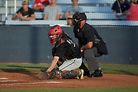 Concord A's catcher Justin Stewart (9) (California University of Pennsylvania) fields a pitch in the dirt as home plate umpire Britton Kennerly looks on during the game against the Mooresville Spinners at Moor Park on July 31, 2020 in Mooresville, NC. The Spinners defeated the Athletics 6-3 in a game called after 6 innings due to rain. (Brian Westerholt/Four Seam Images)