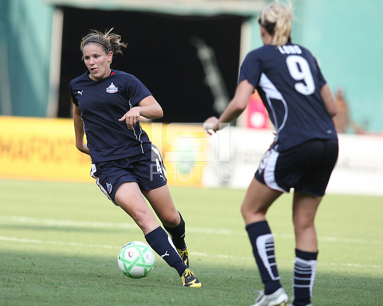 Allie Long #9 of Washington Freedom watches Cat Whitehill #4 move the ball upfield during a WPS match against Chicago Red Stars at RFK Stadium on June 13 2009, in Washington D.C.
