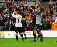ATTENTION SPORTS PICTURE DESK<br /> Pictured L-R: Cedric Van Der Gun and Dorus de Vroes of Swansea thanking the crowd after the final whistle<br /> Re: Coca Cola Championship, Swansea City Football Club v Cardiff City FC at the Liberty Stadium, Swansea, south Wales. Saturday 07 November 2009