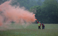 Pictured: Mountain rescue men with a flare help guide a Coastguard helicopter to its landing site at Tafarn y Gerreg in Powys, Wales UK. Wednesday 29 June 2016<br />Re: Rescuers have found a number of the 24 children who went missing the Brecon Beacons.<br />Dyfed-Powys Police said a Coastguard helicopter had found some the children, who are from St Albans, Hertfordshire.<br />The helicopter has landed and the crew are with the children, but their condition is not known.<br />The alarm was raised at about 13:00 BST after the groups went missing around Llyn y Fan Fach, near Abercraf.<br />The children are in their mid teens and were on the beacons as part of their Duke of Edinburgh Award.<br />Mark Moran from Central Beacons Mountain Rescue said his team had been in intermittent phone contact with the four groups of six children before the first group were found.