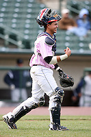 May 10, 2009:  Catcher Jose Morales of the Rochester Red Wings, Triple-A International League affiliate of the Minnesota Twins, congratulates teammates after winning a game at Frontier Field in Rochester, NY.  The Red Wings wore special pink jerseys for Mothers Day.  Photo by:  Mike Janes/Four Seam Images
