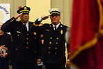 WATERBURY, CT. 20 December 2019-122019BS243 - Soon to be new Waterbury Fire Chief Terry Ballou, right, and Waterbury Police Chief Fernando Spagnolo stand in salute, during the Fire Chief swearing in ceremonies at City Hall on Friday. Terry Ballou replaces former Fire Chief David Martin, who retired earlier this year. Bill Shettle Republican-American
