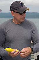 Dr. Steve Turnbull of the University of New Brunswick holds a Xeos satellite tag which will be used to track a porbeagle shark, Lamna nasus, in the Bay of Fundy, New Brunswick, Canada