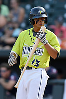 Shortstop Andres Gimenez (13) of the Columbia Fireflies kisses his bat before hitting in a game against the Rome Braves on Sunday, August 20, 2017, at Spirit Communications Park in Columbia, South Carolina. Rome won, 11-6 in 16 innings. (Tom Priddy/Four Seam Images)