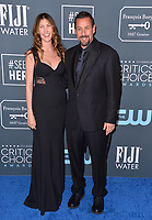 SANTA MONICA, USA. January 12, 2020: Adam Sandler & Jackie Sandler at the 25th Annual Critics' Choice Awards at the Barker Hangar, Santa Monica.<br /> Picture: Paul Smith/Featureflash