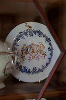 Munros' haind-painted coat of arms on one of the plates displayed in the drawing room china cabinet