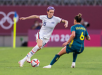 KASHIMA, JAPAN - JULY 27: Megan Rapinoe #15 of the USWNT dribbles past Chloe Logarzo #6 of Australia during a game between Australia and USWNT at Ibaraki Kashima Stadium on July 27, 2021 in Kashima, Japan.