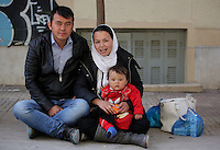 Pictured L-R: 19 year old Ruhoula from Afghanistan with his 18 year old wife Zakia and their 12 month old son Abulfaz in a street near Victoria Square Tuesday 08 March 2016<br />Re: Migrants at Victoria Square, in central Athens, Greece.