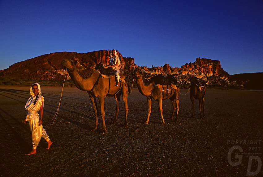 Identical twins with Camels at Rainbow Valley,Northern Territory Australia