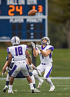 8 October 2016: Amherst College Purple & White Wide Receiver Devin Boehm, a Senior from Wilmette, IL, receives a kick from the Middlebury College Panthers at Alumni Stadium in Middlebury, Vermont. The Panthers edged out the Purple & While 27-26. Mandatory Credit: Ed Wolfstein Photo *** RAW (NEF) Image File Available ***