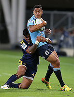 Waratahs Israel Folau, right, in the tackle of Highlanders Malakai Fekitoa in the Super 15 rugby match, Forsyth Barr Stadium, Dunedin, New Zealand, Saturday, March 14, 2015. Credit: SNPA/Dianne Manson