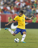 Brazil defender Thiago Silva (3) passes the ball.  In an international friendly, Brazil (yellow/blue) defeated Portugal (red), 3-1, at Gillette Stadium on September 10, 2013.