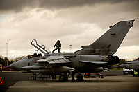 Twilight of the Tornado: Aircrew undertaking a 'walkaround' - making final safety checks before flying at RAF Marham. The Tornado GR4 is being phased out at the base and being replaced by the Lightning F35<br /> <br /> https://www.ft.com/content/c6755884-0034-11e8-9650-9c0ad2d7c5b5