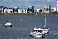 CARDIFF, UK. 2nd April 2017. Boats sail in Cardiff Bay in warm sunny weather.