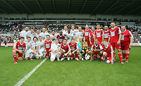 Pictured: Both teams pose for a picture after the game. Sunday, 01 June 2014<br /> Re: Celebrities v Celebrities football game organised by Sellebrity Scoccer, in aid of Swansea City Community Trust, at the Liberty Stadium, south Wales.