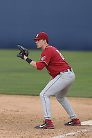 Matt Mendenhall #8 of the Washington State Cougars plays first base during a game against the Cal State Fullerton Titans at Goodwin Field on  February 15, 2014 in Fullerton, California. Washington State defeated Fullerton, 9-7. (Larry Goren/Four Seam Images)