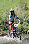 Jo Harris (83) going through the first ford. Mammoth Adventure MTB Ride, Nelson<br /> Photo: Marc Palmano/shuttersport.co.nz