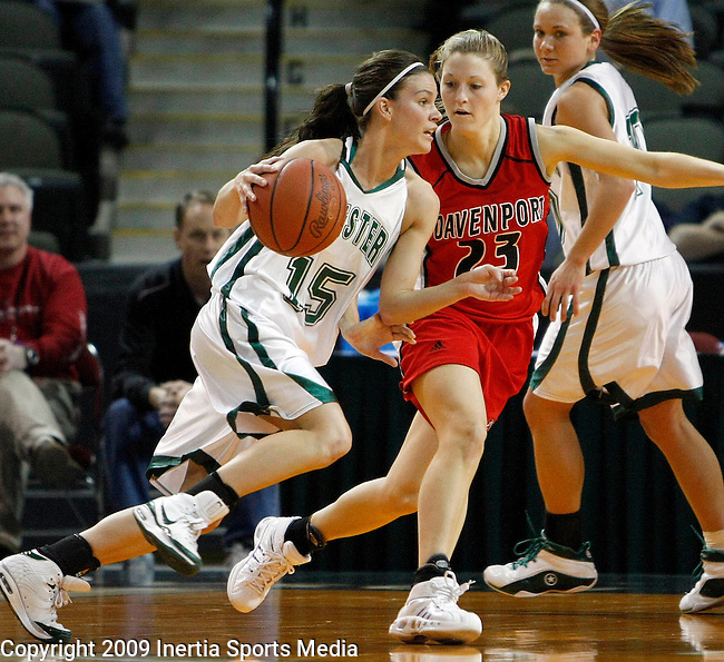 SIOUX CITY, IA - MARCH 13, 2009 --  Sarah Miller #15 of Huntington University drives on Carrie Grubius #23 of Davenport University during their game at the 2009 NAIA DII Women's National Championship at the Tyson Events Center in Sioux City, IA Friday. (Photo by Dick Carlson/Inertia)