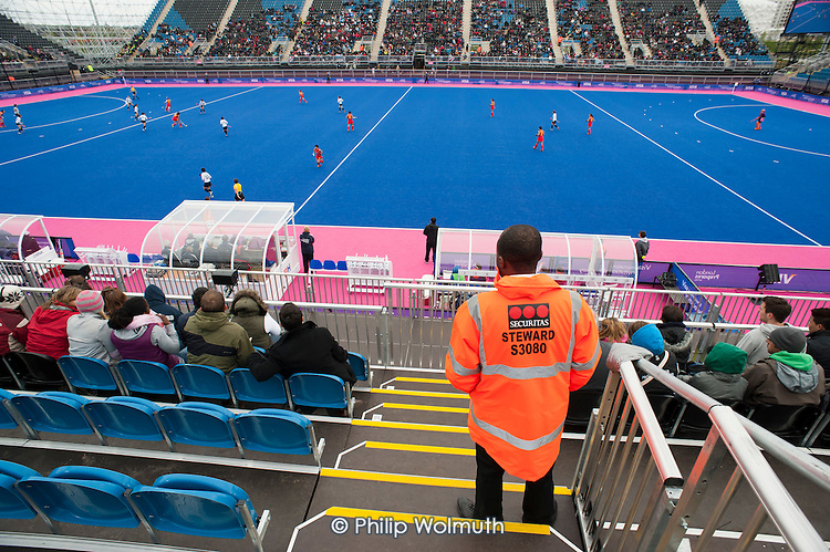 A security guard employed by private contractor Securitas on duty during an international women's hockey event at the Riverbank Arena in the Olympic Park, Stratford.
