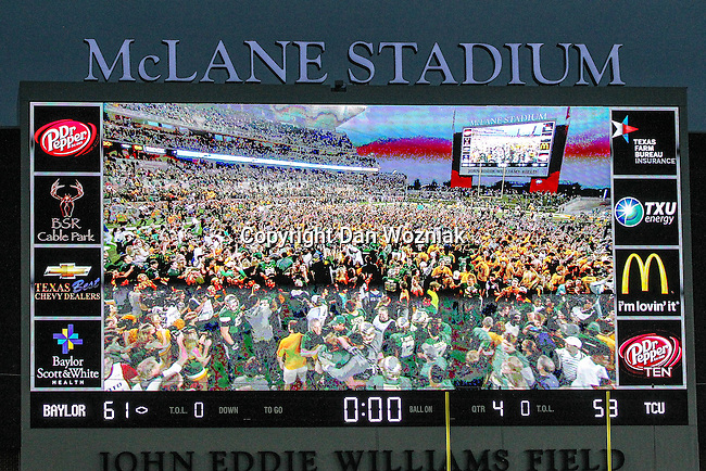 Fans invade the field, as shown on the fiel's big screen, after the game between the TCU Horned Frogs and the Baylor Bears at the McLane Stadium in Waco, Texas. Baylor defeats TCU 61 to 58.