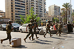 Lebanese Army soldiers patrol the clashes area in the southern suburb of the capital Beirut, on October 14, 2021. - Gunfire killed several people and wounded 20 at a Beirut rally organised by the Shiite Hezbollah and Amal movements to demand the dismissal of the Beirut blast lead investigator, the state-run National News Agency said. Photo by Marwan Bou Haidar