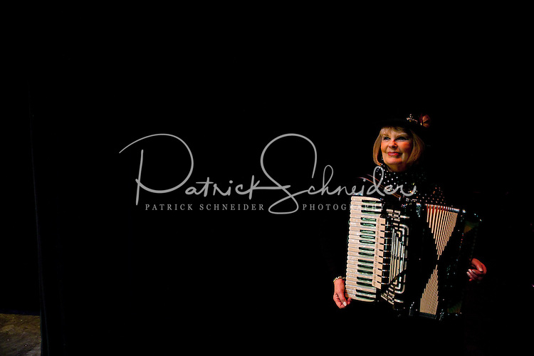An accordion players waits to go onstage during the 20th year of the Tosco Music Party, held at the Overcash Academic and Performing Arts Center Dale F. Halton Theater Central Piedmont Community College. The annual event, named after John Tosco, owner of the Tosco Music Studio, is designed to showcase professional and amateur musicians.