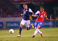SAN JOSE, COSTA RICA - September 06, 2013: Fabian Johnson (23) of the USA MNT chases after Bryan Ruiz (10) of the Costa Rica MNT during a 2014 World Cup qualifying match at the National Stadium in San Jose on September 6. USA lost 3-1.