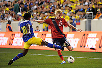 Brek Shea (11)  of the United States is defended by Gabriel Achilier (18)  of Ecuador. The men's national team of the United States (USA) Ecuador (ECU) during an international friendly at Red Bull Arena in Harrison, NJ, on October 11, 2011.