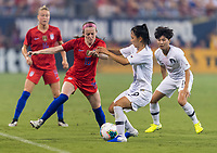 CHARLOTTE, NC - OCTOBER 3: Rose Lavelle #16 of the United States tries to get past Jang Selgi #9 of Korea Republic during a game between Korea Republic and USWNT at Bank of America Stadium on October 3, 2019 in Charlotte, North Carolina.