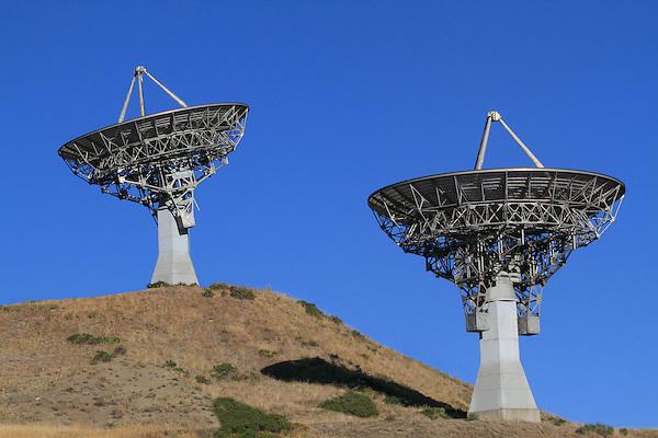 Two parabolic or round radio telescopes for radio astronomy pointing skywards, Front Range Mountains, Colorado, USA .  John leads private photo tours in Boulder and throughout Colorado. Year-round Colorado photo tours.