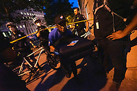 A Dominoes Pizza employee leaves a roped-off area after making a delivery as demonstrators gather in support of Black Lives Matter near the White House in Washington D.C., U.S., on Tuesday, June 23, 2020.  Trump tweeted that he authorized the Federal government to arrest any demonstrator caught vandalizing U.S. monuments, with a punishment of up to 10 years in prison.  Credit: Stefani Reynolds / CNP/AdMedia