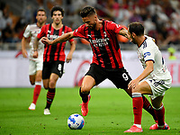 Calcio, Serie A: AC Milan - Cagliari calcio, Giuseppe Meazza (San Siro) stadium, Milan on August 29, 2021.  <br /> Milan's Olivier Giroud (l) in action with Cagliari's Diego Godin (r) during the Italian Serie A football match between Milan and Cagliari at Giuseppe Meazza stadium, on August 29, 2021.  <br /> UPDATE IMAGES PRESS/Isabella Bonotto
