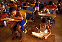 Children sitting at their desks and working at school, Yap Micronesia