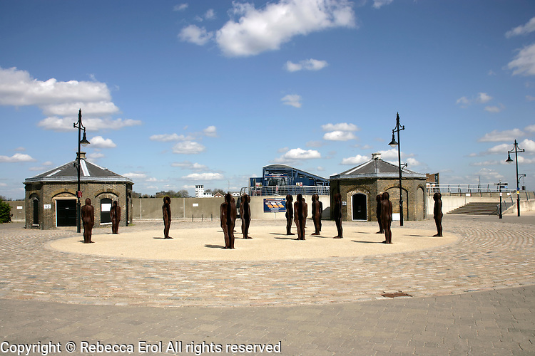 Peter Burke's cast iron statues on the waterfront at Royal Woolwich Arsenal, southeast London, UK