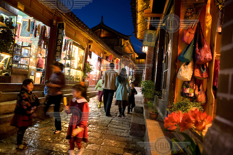 Tourist shops selling souvenirs in the old city of Lijiang, a centre of Nakhi culture which is a UNESCO World Heritage Site.